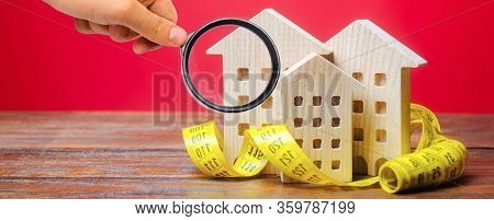 Miniature Wooden Houses And Measuring Tape. Home Appraisal And Property Valuation Concept. Housing C
