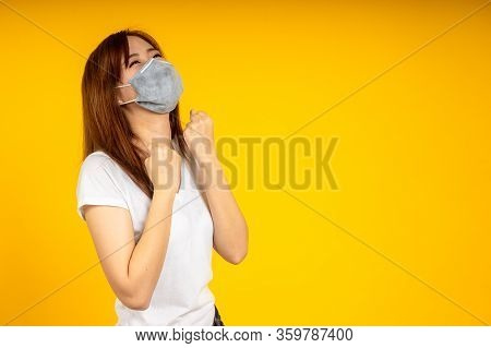 Asian Woman Is Glad And Wearing Hygienic Mask To Protect Virus, Covid 19 Or Corona Virus Infection A