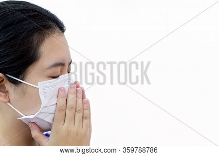 Coronavirus, Woman Wearing A Mask To Protect Her Face From The Corona Virus And Prevent The Spread O