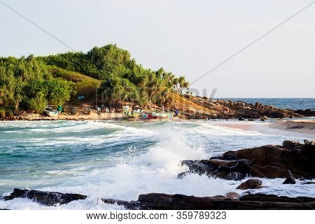 Untouched Tropical Beach With Rocks In The Water And White Waves In Sri Lanka