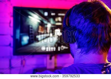 Esports, Gaming On Pc - Man Playing Online Multiplayer Shooter Game. Back View