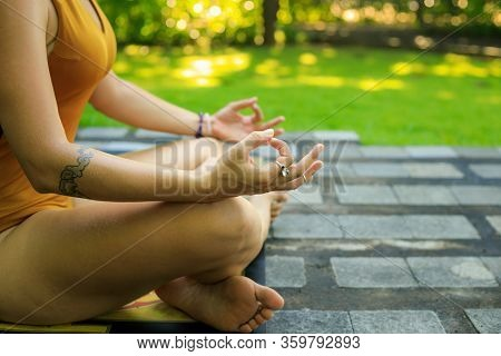 Yoga Lifestyle. Close Up Gyan Mudra. Lotus Pose. Young Woman Meditating, Practicing Yoga And Pranaya