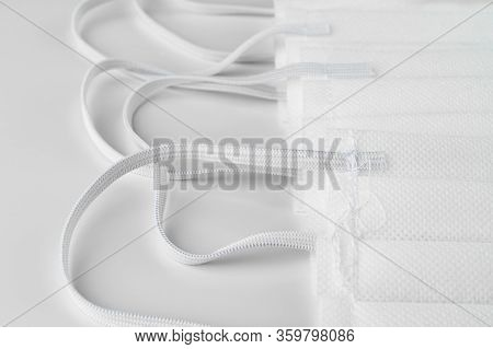 Protective Face Masks On A White Background. Copy Space On The Left.