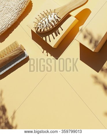 Bathroom, Spa Accessories Concept Flat Lay On The Beige Background. Top View Frame With Hairbrush ,