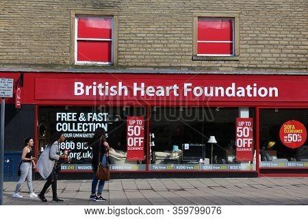 Huddersfield, Uk - July 10, 2016: People Walk By British Heart Foundation Charity Shop In Huddersfie