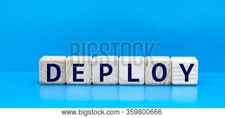 Concept Word Deploy On Cubes On A Blue Background