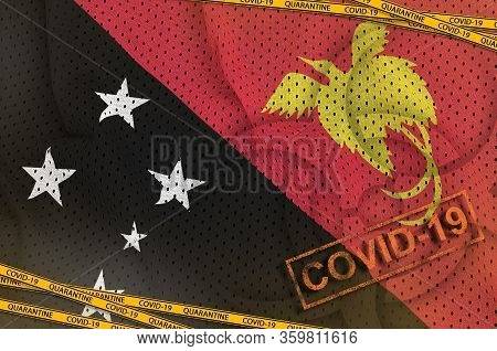 Papua New Guinea Flag And Covid-19 Biohazard Symbol With Quarantine Orange Tape And Stamp. Coronavir