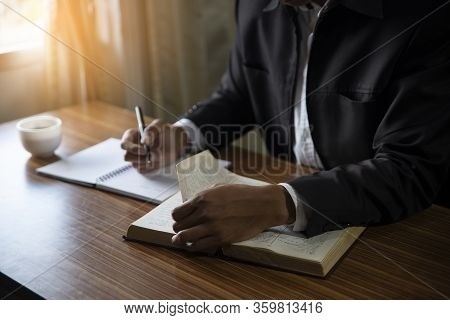 Male Hand Of Planner Writing Daily Appointment On 2020 Calendar Book,working Space At Home.asian Man
