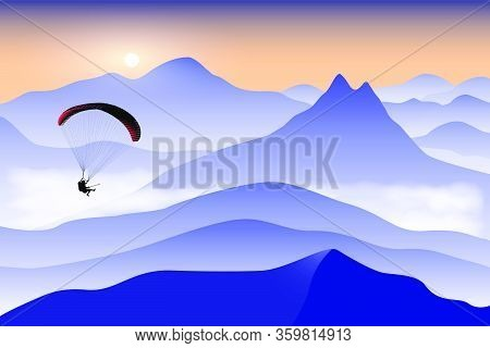 Silhouette Of Flying Paraglider Take A Selfie With Action Camera Above The High Mountains At Sunrise
