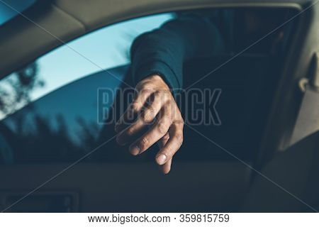 A Thief Steals In The Car In Street