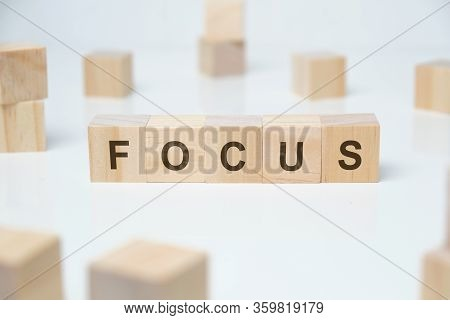 Modern Business Buzzword - Focus. Word On Wooden Blocks On A White Background. Close Up.