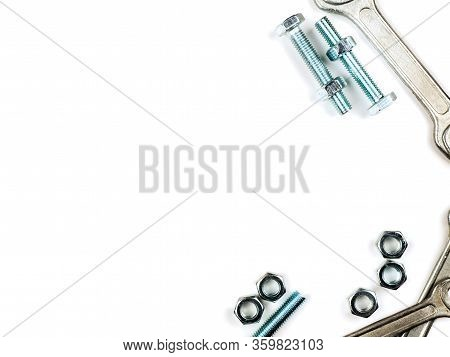 Text Insertion Frame Lined With Bolts, Nuts And Wrenches
