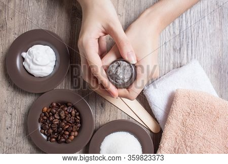 A Young Woman Holds A Jar Of Homemade Coffee Scrub. Spa, Beauty. Ingredients For Making A Scrub, Cof