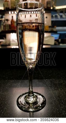 One Glass Of Sparkling Wine On Background