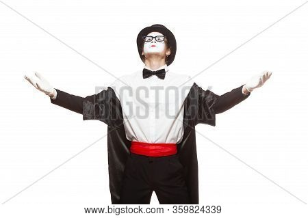Portrait Of A Male Mime Artist Performing, Isolated On White Background. Standing With His Hands Rai
