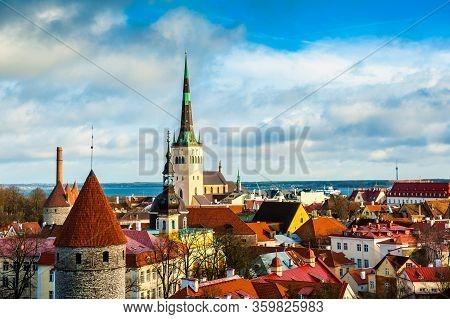 Panoramic Cityscape Of Tallinn, Estonia. Old Town With St. Olaf Church And Historical Tallinn City W