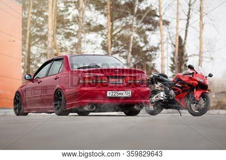 Krasnoyarsk, Russia - April 3, 2020: Red Honda Accord Euror Cl1 Sports Car And The Honda Cbr 600 Rr