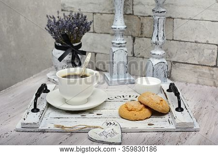 White Cup Of Coffee And Homemade Cookies On A Wooden Tray, Dry Lavender In A Vase And Candlesticks I
