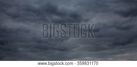 Wide Angle Nature Dramatic Sky Background, Texture For Design. Dark Blue Gloomy Sky With Stormy Clou