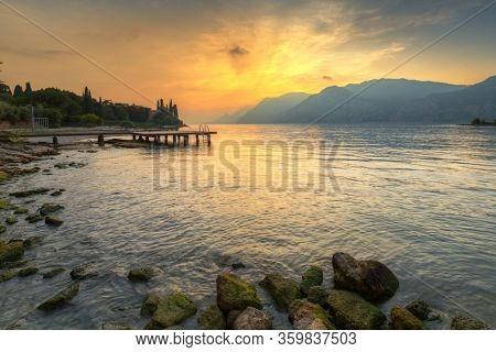 Beautiful coastline of Garda lake at sunset, northern Italy