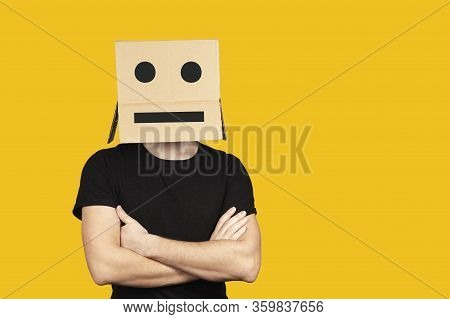 Portrait Of An Indifferent Man With A Box And Cartoony Emotions On His Head. Unhappy People.