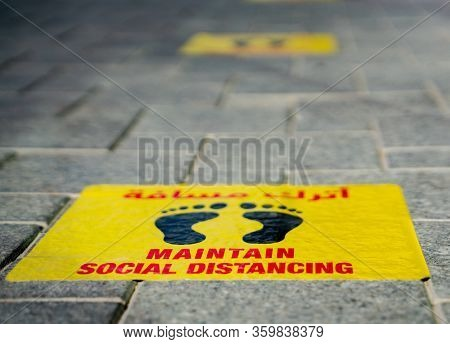 Maintain Social Distancing Stickers Pasted On The Floor In Front Of The Restaurant In Qatar