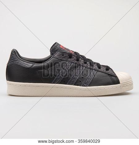 Vienna, Austria - August 6, 2017: Adidas Superstar 80s Black And Beige Sneaker On White Background.