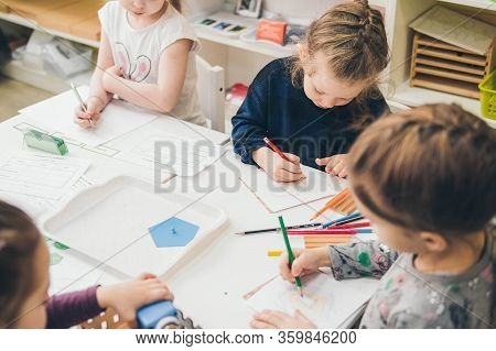Perm/russia - June, 05, 2019: Pupils Working At Tables In Montessori School. Learning Materials In A