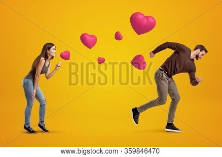 Side View Of Young Girl Following With Her Eyes Young Man Whos Running Away Being Chased By Cute Val