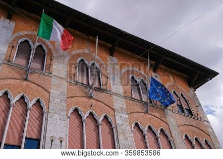 Italy And European Union Flags Waving, Europes Flag Is Lowered To Half-mast, As Symbol For The Itali