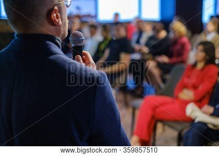 Male presenter speaks to audiences at workshop