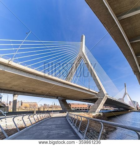 Boston Zakim bridge over Charles river around Boston bay harbor at Boston downtown MA USA. Boston is the capital and most populous cityof the Commonwealth of Massachusetts in the United States