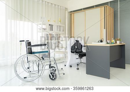 Interior of empty doctor office examination room workplace with equipment in clinic medical hospital of state health care center. Using for healthcare hospital industry concept.