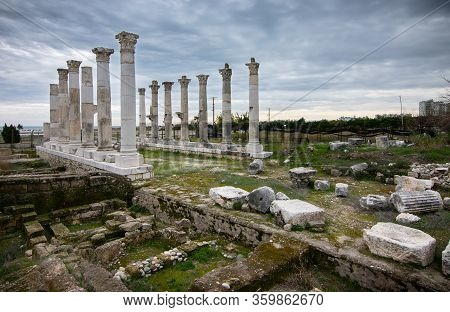 Ruins Of A Roman Temple With Pieces Of Columns And Vertical Columns That Stand In A Cloudy Day