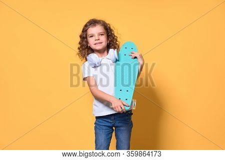 Active And Happy Kid Having Fun With Penny Board, Smiling Face Stand Skateboard. Penny Board Cute Sk