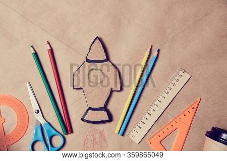 Launch Rocket On Paper Backdrop. Start-up Idea. Development And Creativity Concept. New Learning And