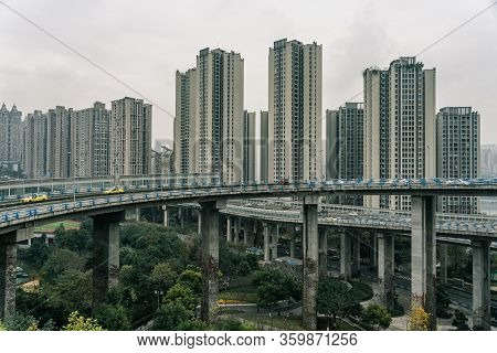 Chongqing, China - Dec 20, 2019: Elevated Flyover With High Residence Building