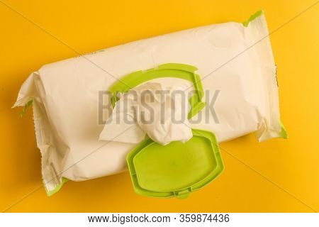 Baby Wipes Over Yellow Background - Open Pack Of Baby Wipes.