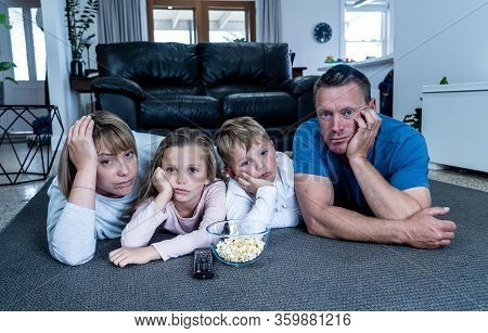 Coronavirus Lockdow. Bored Family Watching Tv Helpless In Isolation At Home During Quarantine Covid