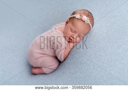 Lovely newborn sleeping comfortable on stomach