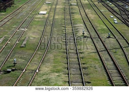 Empty Railroad Tracks View From Above. Abandoned Railroad Tracks. Railroad Rails On A Background Of