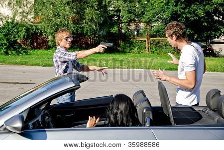 Bandit With A Gun Threatening Young Couple In The Car