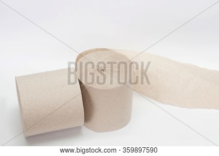 Roll Of Toilet Paper. Two Rolls Of Paper. Simple Toilet Paper On A White Background. A Skein Of Pape