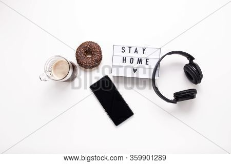 Stay Home, Boxing Inscription. Remote Online Work At Home. Headphones Tablet And Diary On A White Ba