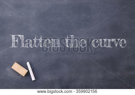 Blackboard With Flatten The Curve About Coronavirus Pandemic, Covid 19.