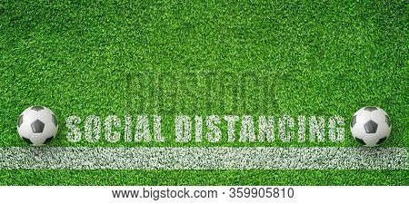 Corona Virus And Social Distancing Concept : Two Soccer Balls Put On Green Artificial Grass That Kee