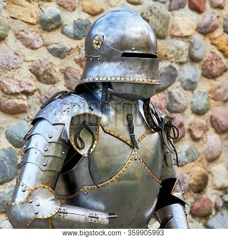 Vintage Knight Medieval Suit Of Armor. Metal Armor To Protect The Warrior.