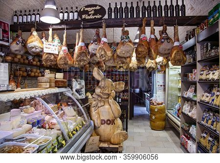 Italy, Bari, August, 2017 - Italian Grocery Store With Hamon Or Jamon, Mixed Cheeses And Wine In Bar