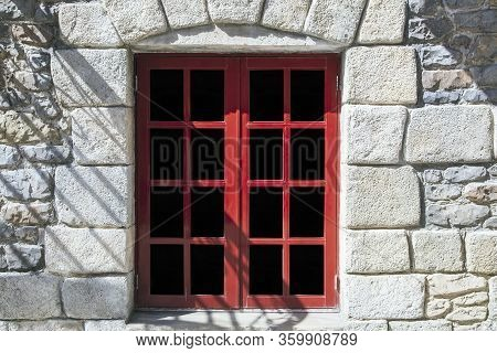 Stone Castle, Glass Door To The Building Entrance, Old Wood Doorways And Window In A Stone Wall, Vin