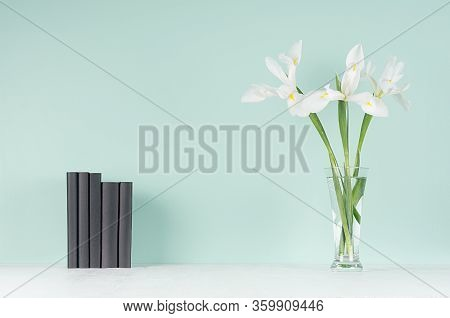 Spring Soft Students Workplace With Row Black  Books, Fresh White Flowers In Trasparent Glass Vase O